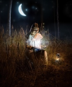 beautiful-woman-sitting-at-night-forest-and-reading-fairy-tale-book
